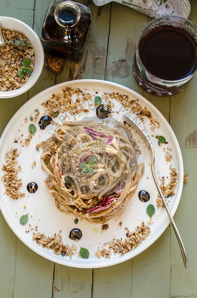 Whole spaghetti with walnut and radicchio pesto with marjoram scented breadcrumbs