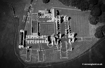 aerial photograph of Castle Acre Priory, Norfolk England UK.