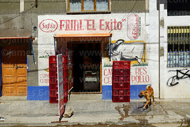 Dog outside butcher's shop, Uyuni, Bolivia