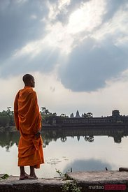 Monk looking at Angkor Wat temple, Cambodia
