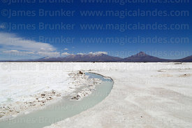 Channel formed by removing salt blocks, Tata Sabaya (R) volcano in background, Salar de Coipasa, Oruro Department, Bolivia