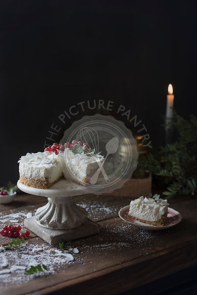 Coconut cheesecake in a rustic kitchen