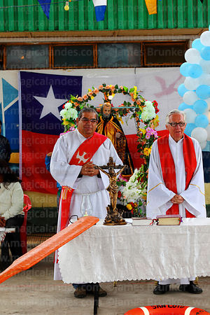 Former bishop of Arica Hector Vargas Bastides (L) and priest after holy communion during mass for St Peter and St Paul festival, Arica, Chile