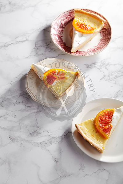 Cheesecake with caramelized red oranges