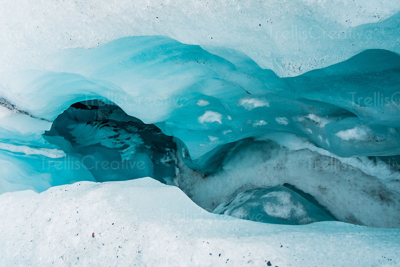 A crevasse in a aqua colored glacier in Iceland