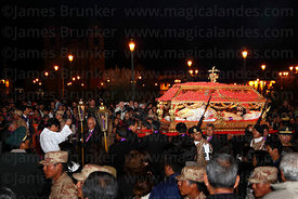 Crowds with Santo Sepulcro / Crucified Christ during Good Friday procession , Cusco , Peru