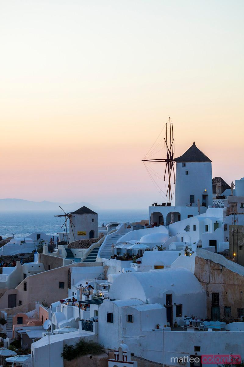 Romantic sunset over the windmills, Greece, Santorini