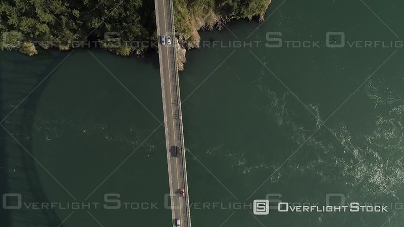 Birds eye view looking down to cars driving across Puget Sound ocean water on big Deception Pass bridge in Washington State