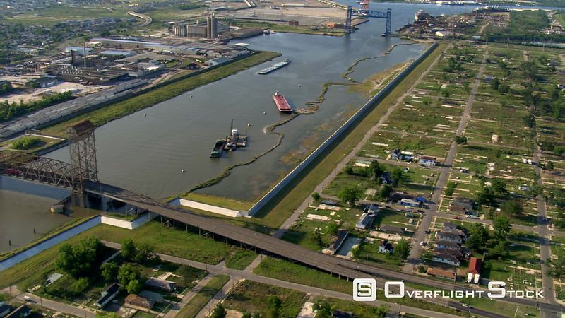 Flight paralleling canal beside Katrina-damaged lots in New Orleans.