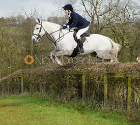 Harriet Rimmer jumping a hedge