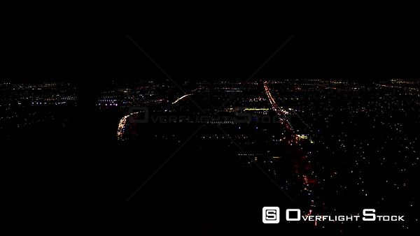 PAN NIGHT AERIAL VIEW OF FREEWAY TRAFFIC SEEN THROUGH HELICOPTER COCKPIT, LOS ANGELES CALIFORNIA