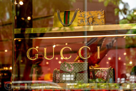 SINGAPORE CITY, SINGAPORE - OCTOBER 09, 2016: A window display of handbags at a Gucci store in Singapore.  Gucci is an Italian luxury brand of fashion and leather goods with stores thought the world.
