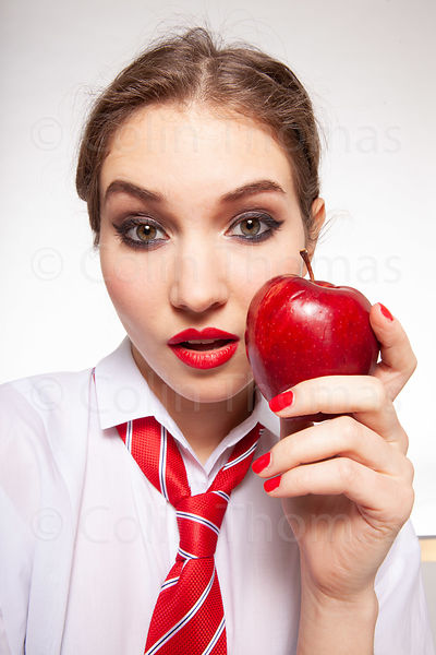 Cool teenager with apple, strawberry photos