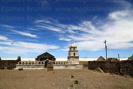 Rustic church in abandoned village of Chantani, Salar de Uyuni in background, Bolivia
