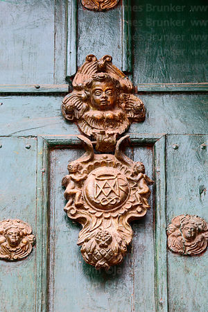 Detail of door knocker with Auspice Maria symbol on main entrance, Belén church, Cusco, Peru