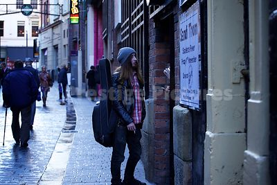Passersby Walking Through the world famous Mathew Street