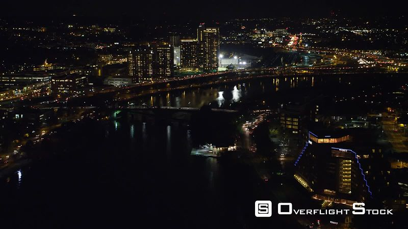 Flying above the Charles River in Boston at night.