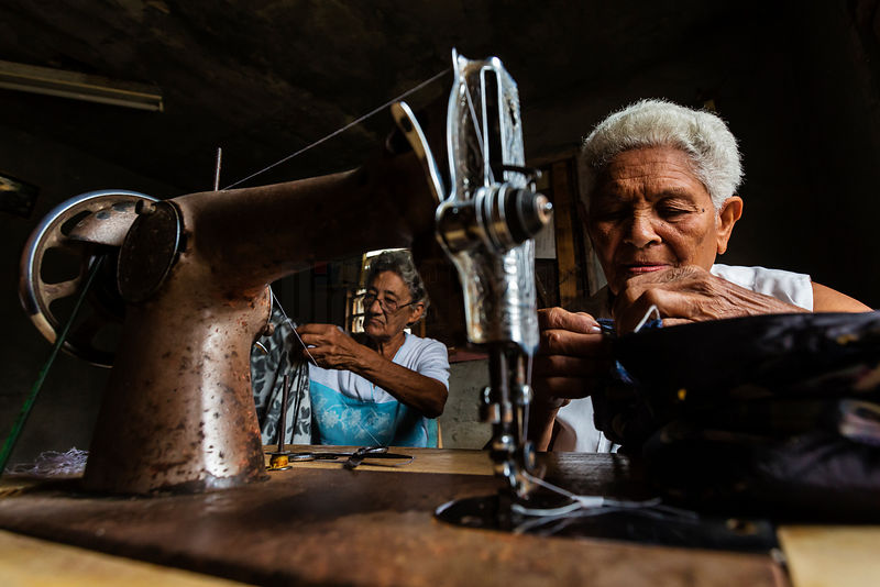 Women Sewing with a Machine in a Home