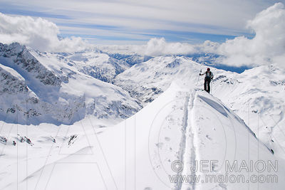 Skier on a snow ridge