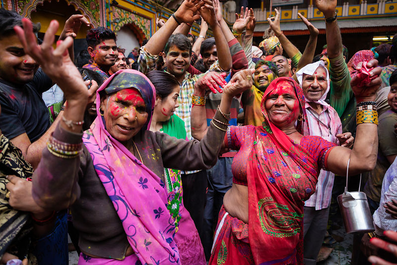 Revellers at the Dwarkadheesh Temple During Holi Celebrations