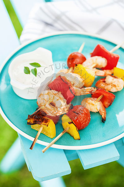 Shrimps and vegetables baked on grill outside