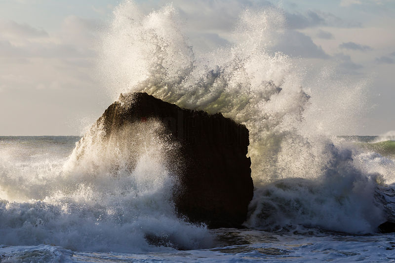Wave Beating Against a Large Rock