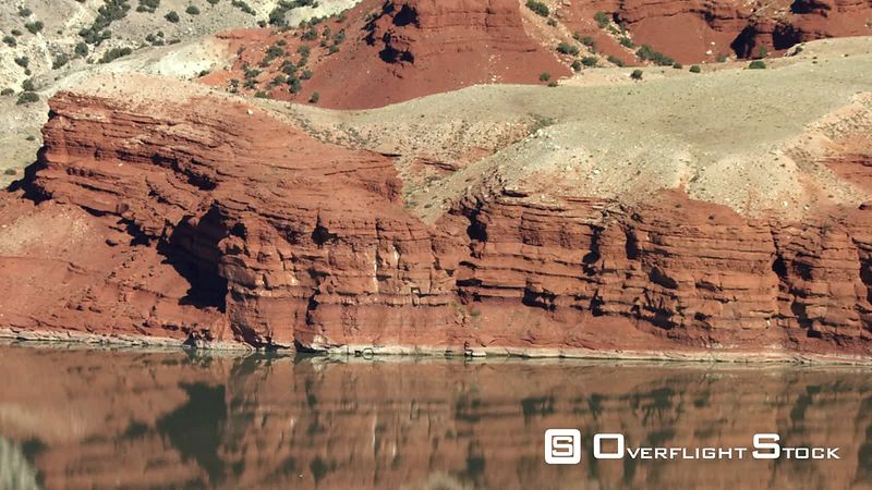 Dramatic red rock formations stand above the shore of Bighorn Lake in the high desert of norhtern Wyoming