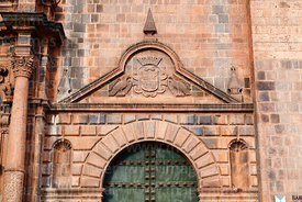 Detail of stone carvings above right entrance of cathedral, Cusco, Peru