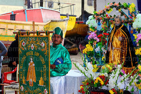 Devotee with banner and statue of St Paul at St Peter and St Paul festival, Arica, Chile