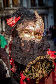 Woman with beautifully decorated Carnival Mask and Lace Fan