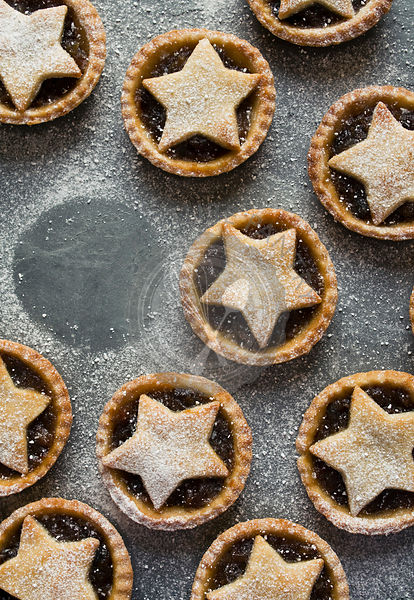 Mince Pies on slate background with icing sugar