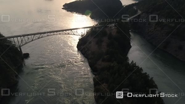 Washington bridge at Deception Pass crossing Puget Sound with lens flare