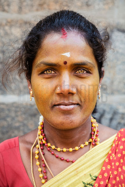 Portrait of a Woman with Light Eyes and Turmeric on her Face