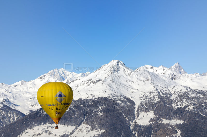 "Hot air balloon in flight over the Aosta Valley region of the northern Italian Alps. This is the ""Roof of Europe"": Mont Blanc is the peak on the left, Grande Jorassos is the peak on the right"