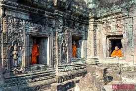 Three buddhist monks at Angkor Wat, Siem Reap, Cambodia
