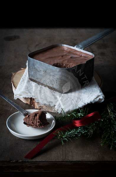 Single malt & chocolate mousse in vintage tin pot on dark wooden ground with Christmas decoration. Top view