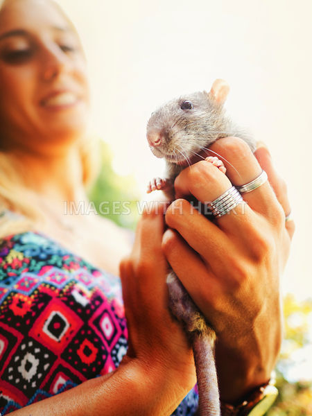 smiling woman holding happy rat