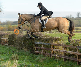 Anna Hanson jumping a hedge on Deane Bank