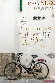Bicycle against a wall in the old town, Cordoba, Spain