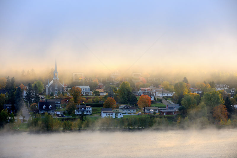 Early morning mist and autumn colours in Grande Piles Village and St Maurice river. Quebec, Canada, October 2010