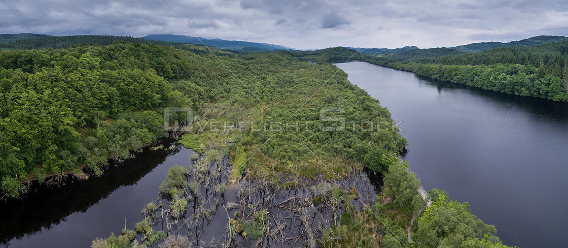 Aerial view overlooking wetland habitat created by European beavers (Castor fiber) between Loch Coille-Bharr and Dubh Loch, Knapdale Forest, Argyll and Bute, Scotland, UK, June 2016.