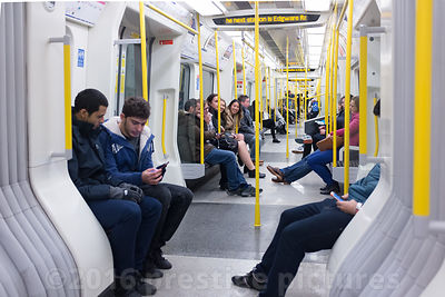 Passengers sitting in an S Stock Train on the Circle Line in London