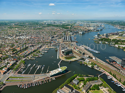 Amsterdam, The NEMO Science useum, the Oosterdok, Oosterdoks Island (Oosterdokseiland, ODE),  the Amsterdam Centraal Railway Station (Amsterdam CS) and the river IJ. Amsterdam, Netherlands