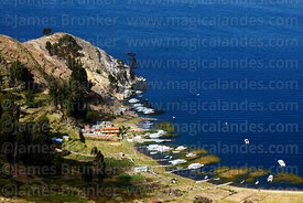 View looking down on boats moored in bay at Japapi, Sun Island, Lake Titicaca, Bolivia