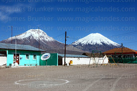 CTR Telecomunicaciones satellite phone dish in square, Payachatas volcanos in background, Caquena, Region XV, Chile