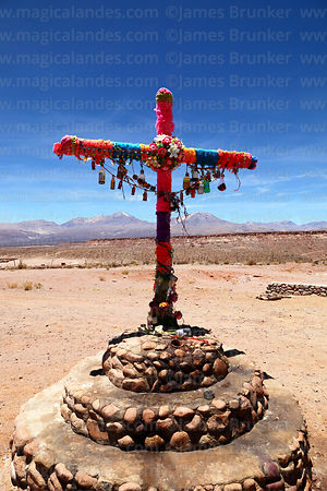 Cross covered with wool with offerings for Pachamama (Mother Earth), near Caspana, Region II, Chile