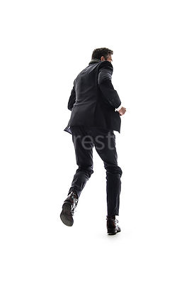 A mystery man in a suit, running away, in semi-silhouette – shot from mid level.