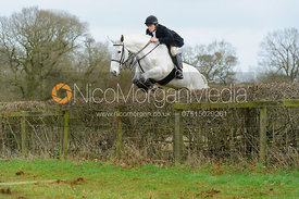 William Grant jumping a hedge at Goadby Hall - The Belvoir Hunt at Goadby Hall 24/12