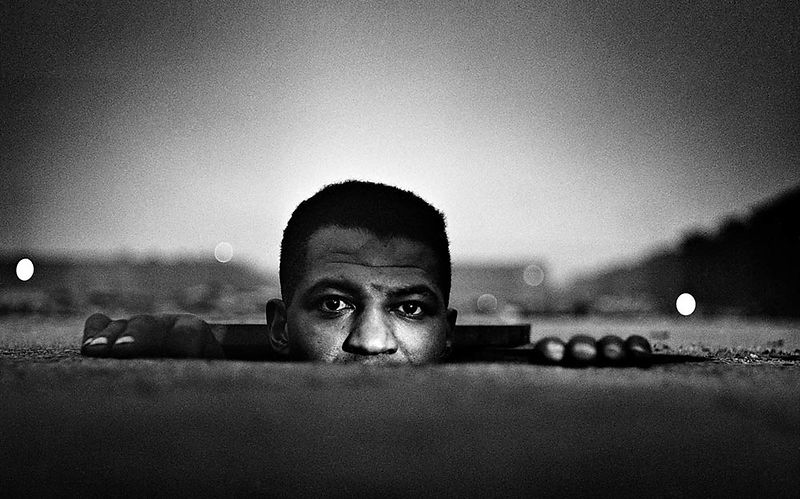 Gordon Parks. Emerging Man, Harlem, New York, 1952. Copyright The Gordon Parks Foundation.