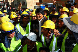 President Evo Morales (centre) with Mi Teleferico company workers during opening ceremony of the Yellow Line cable car, La Paz, Bolivia